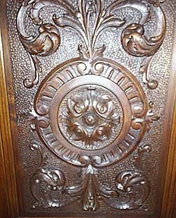 carved door panel on renaissance cabinet