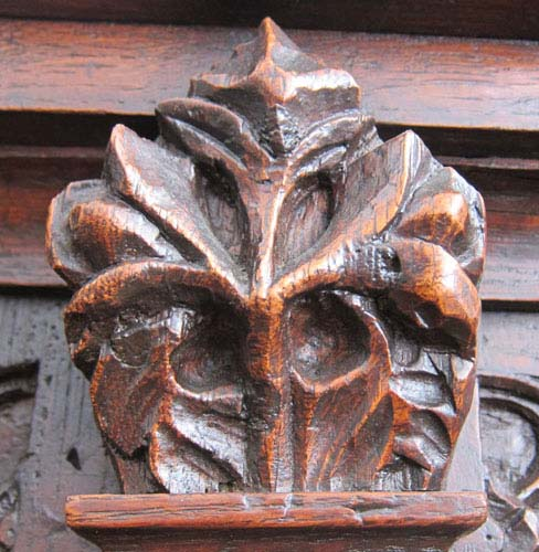 carved vegetation on cabinet