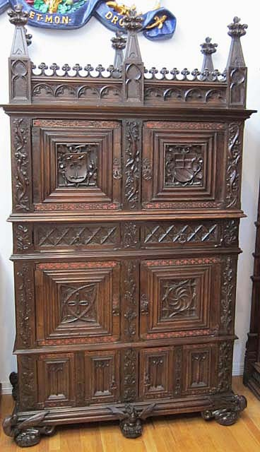 gotic cabinet with coats of arms and basilisks