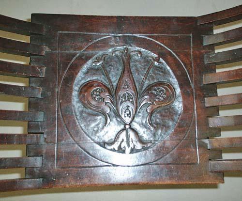 Antique savonarola chair with medici coat of arms