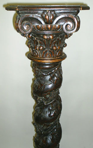 Pair of intricately carved solid oak columns with wine motif