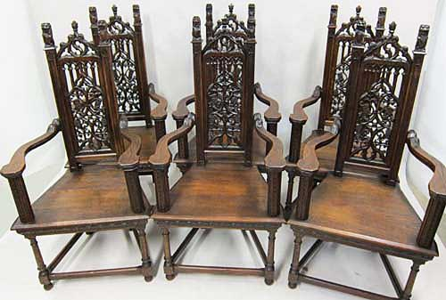 6 gothic antique armchairs with open tracery and crouching lions